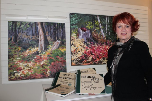 Cecelia with an couple of paintings and some of her past sketchbooks